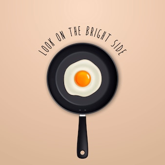 Look on the bright side - quote and fried egg on a black pan illustration.