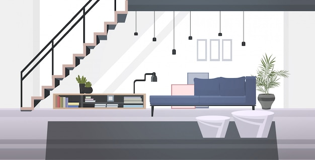Lounge area or waiting room with sofa, book shelf, coffee table and staircase