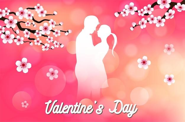 Любовь и день святого валентина влюбленные держат сердечко из бумаги