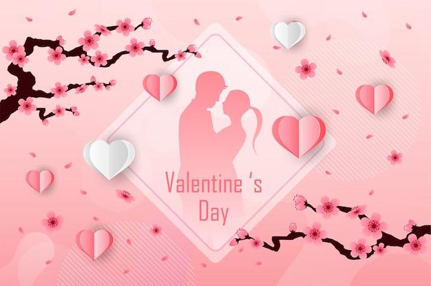 사랑과 발렌타인 데이 연인들은 초원과 종이 예술 심장에 서 있습니다.