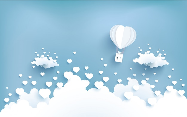 Love balloons fly over the clouds