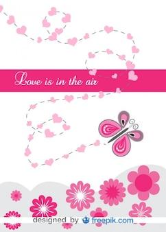 하트와 꽃으로 둘러싸인 사랑 나비