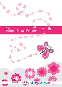 Love butterfly surrounded by hearts and flowers