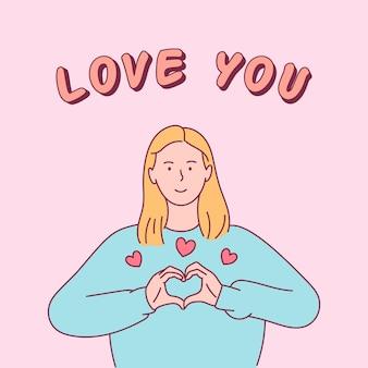 Концепция любви. молодая женщина показывает знак сердца.
