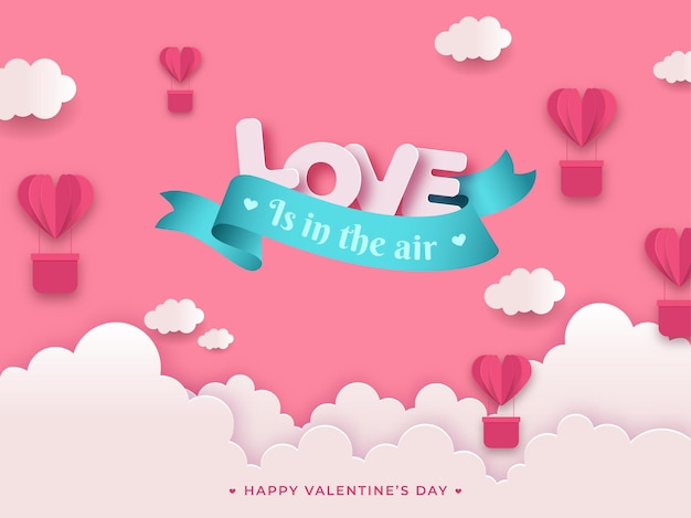 Love is in the air message text with paper cut heart shape hot air balloons and clouds on pink background for valentine's day.