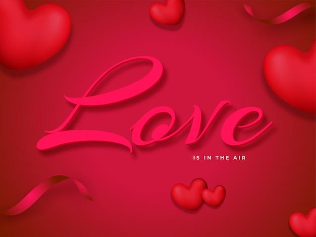 Шрифт love is in the air с 3d-сердечками и лентой конфетти, украшенной красными и розовыми цветами.