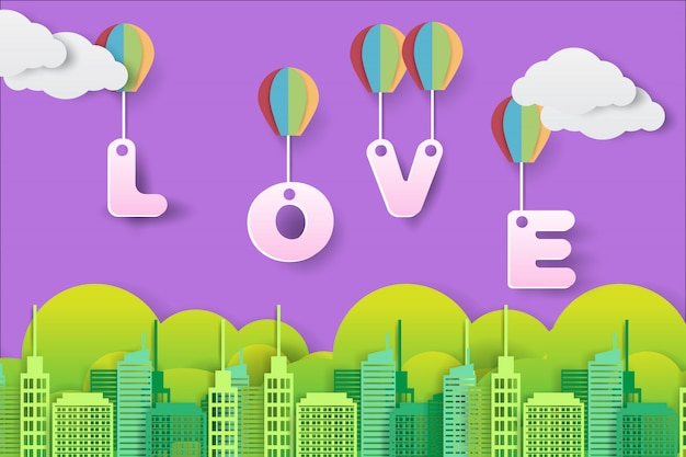 Love text flies over the city with a hot air balloon in paper art style