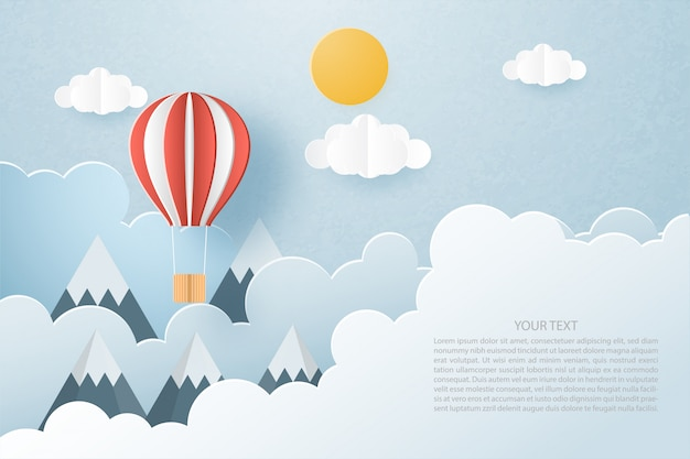 Love to travel concept. origami made hot air balloon flying on clouds and sky background and space.