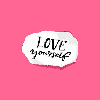 Love yourself. positive quote about self acceptance. handwritten note on torn piece of paper, pink background.