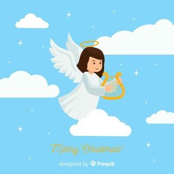 Lovely christmas angel background in flat design