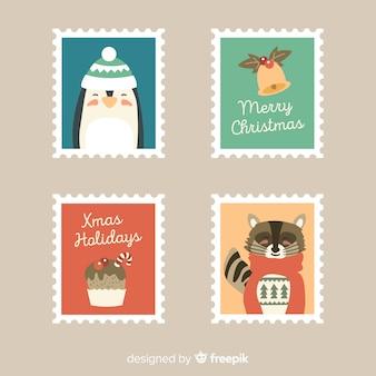 Bella collezione di francobolli natalizi con design piatto