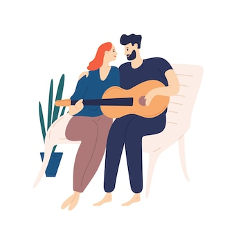 Lovely couple sitting on bench and playing guitar. pair of young adorable man and woman cuddling and singing songs on romantic date. boy and girl in love