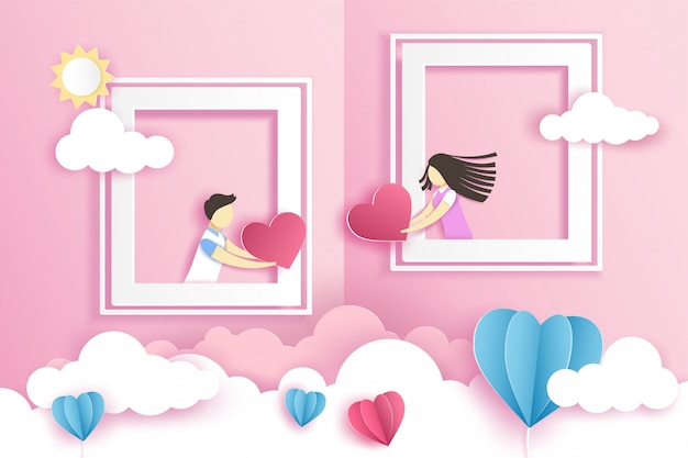 Lovely couple in the windows with origami heart in valentine's day with .