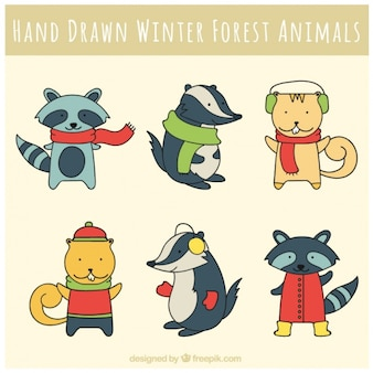 Lovely forest animals wearing winter clothes