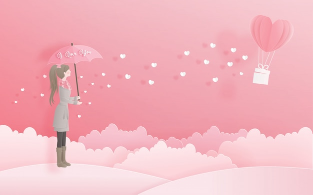 Lovely girl holding an umbrella looking at heart balloon, valentine's day and card