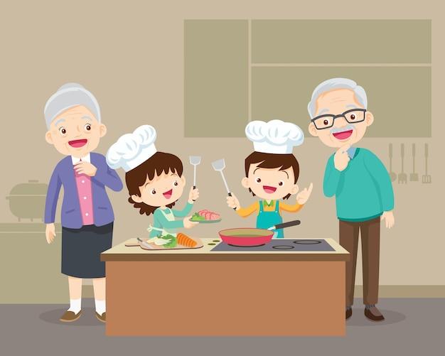 孫の男の子と女の子がキッチンで料理をしている素敵な祖父母