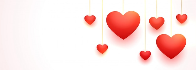 Lovely hanging red love hearts with text space