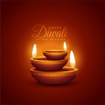 Lovely happy diwali background with realistic diya