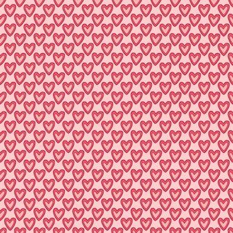 素敵なハートのパターン。バレンタインデザインの背景。かわいいシームレスパターン。ピンクのハートが少し入ったテキスタイルプリント。