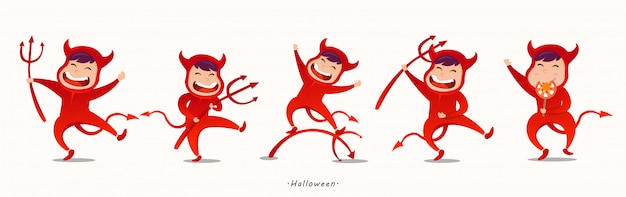 Lovely kids in halloween devil costumes.