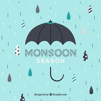 傘を持つ素敵なモンスーン季節のコンポジション