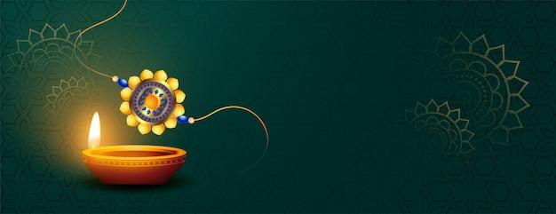 Прекрасный баннер ракша бандхан с дия и ракхи