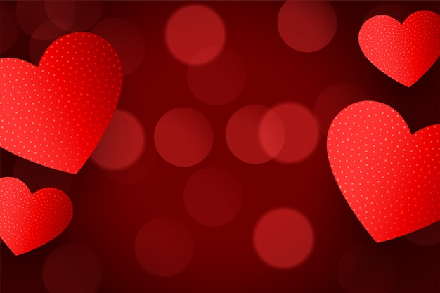 Lovely red hearts background with bokeh effect