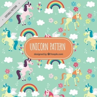 Lovely unicorns pattern with rainbows and flowers