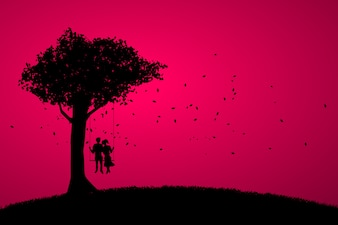 大きな木の下でブランコに一緒に立地恋人カップル。