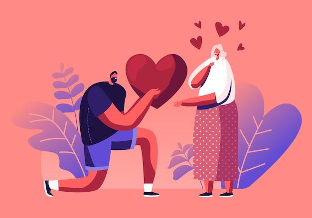 행복한 발렌타인 데이에 무릎에 서있는 여자 친구에게 거대한 마음을 제시하는 사랑하는 남자 친구. 만화 평면 그림