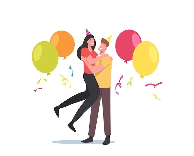 Влюбленная пара обнимается, мужские и женские персонажи в праздничных шапках, конфетти и воздушных шарах вместе отмечают годовщину. празднование партии молодого мужчины и женщины. мультфильм люди векторные иллюстрации