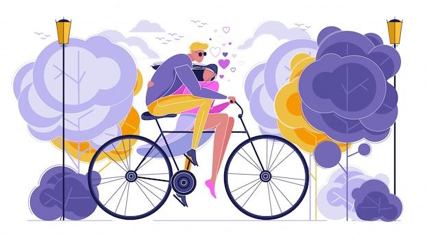 Влюбленная пара, езда на велосипеде вместе в парке.