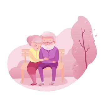 Влюбленная пожилая пара, старший муж и жена, сидя на скамейке.