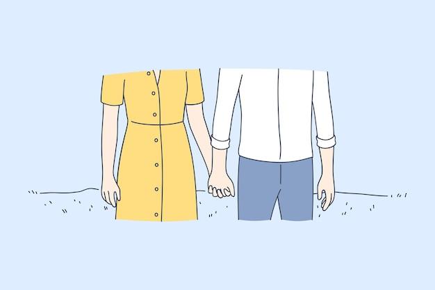 愛する幸せなカップルの漫画のキャラクターが立って、屋外で手をつないで