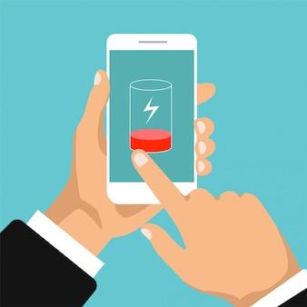 低バッテリーコンセプト。スマートフォンは充電が必要です。携帯電話の画面に触れる手。フラットなデザイン。図。