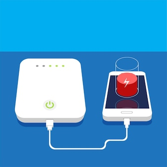 Low battery smartphone charging with external power bank on table