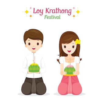 Loy krathong festival, boy and girl in traditional thai clothing, national costume sitting, celebration and culture of thailand