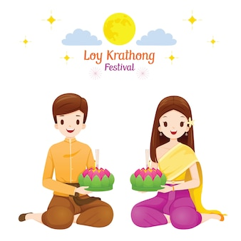 Loy krathong festival, couple in traditional thai clothing, national costume sitting, celebration and culture of thailand