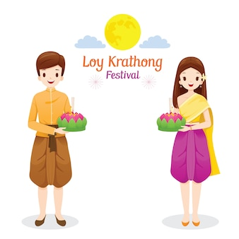 Loy krathong festival, couple in traditional thai clothing, national costume standing, celebration and culture of thailand