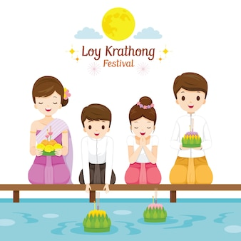 Loy krathong festival, family in traditional thai clothing, national costume sitting, celebration and culture of thailand