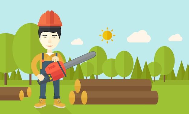 Lumberjack cuts a tree by chainsaw