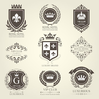 Luxurious heraldic emblems and badges with shields and crowns