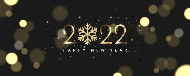 雪の結晶とぼやけたキラキラ粒子と豪華な2022年明けましておめでとうございます