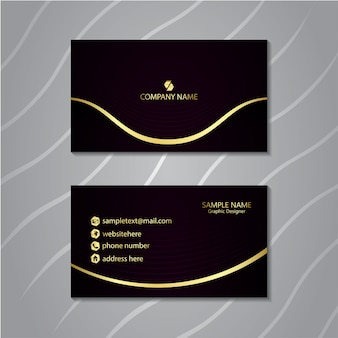 Luxury business card with glowing gold line.