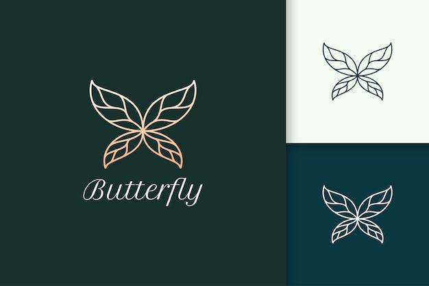 美容とファッションのブランドのための葉の翼を持つ豪華な蝶