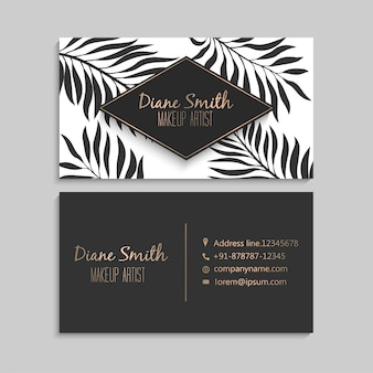 Luxury dark and gold business card  with tropical leaves