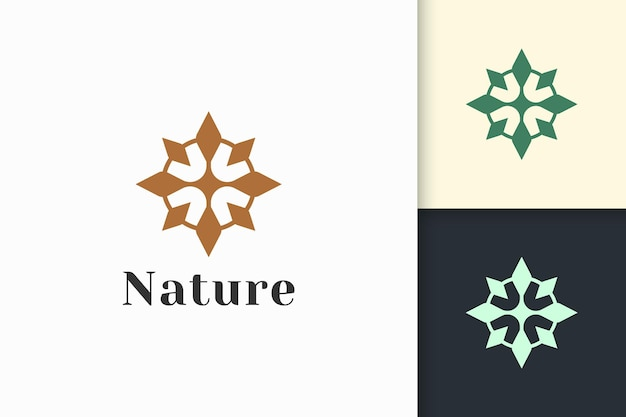 Luxury and feminine beauty care or cosmetic logo in flower shape