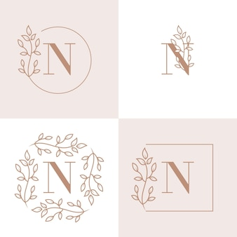 Luxury letter n logo design with floral frame background template