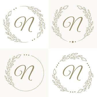Роскошный дизайн логотипа буква n с цветочной рамкой фона шаблона