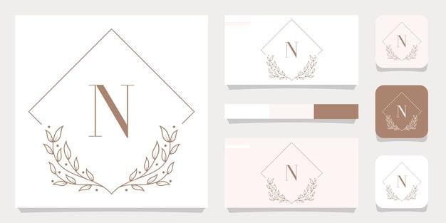 Luxury letter n logo design with floral frame template, business card design